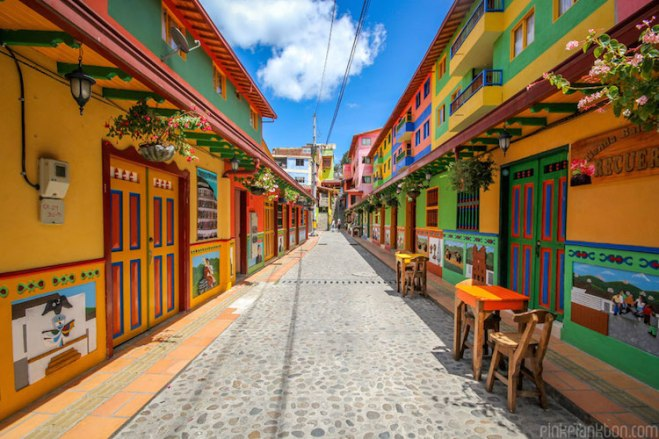 View of a street lined with colorful buildings.